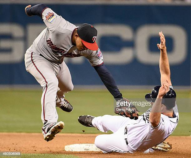Seth Smith of the San Diego Padres steals second base ahead of the tag of Eduardo Escobar of the Minnesota Twins during the sixth inning of a...