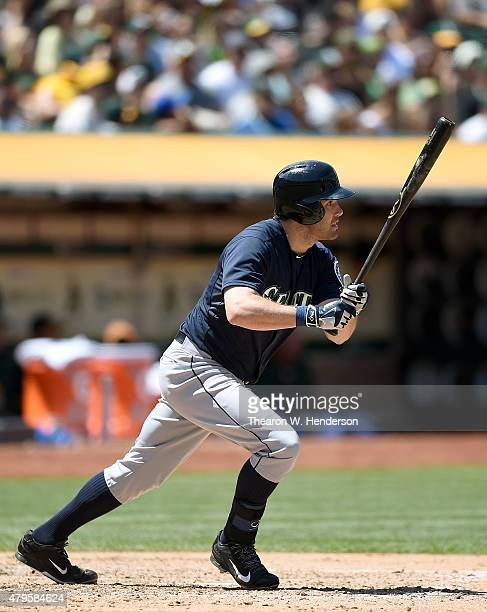 Seth Smith of the Seattle Mariners hits a tworun rbi single scoring Robinson Cano and Nelson Cruz#23 against the Oakland Athletics in the top of the...