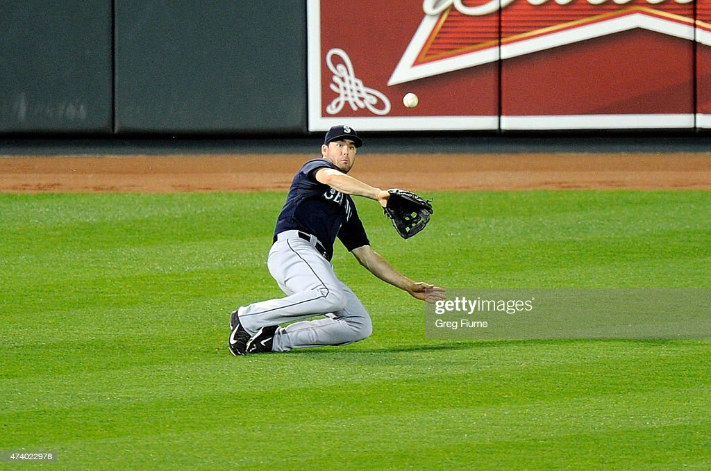 Seth Smith #7 of the Seattle Mariners makes a sliding catch on a fly ball in the sixth inning off the bat of Chris Davis #19 (not pictured) of the Baltimore Orioles at Oriole Park at Camden Yards on May 19, 2015 in Baltimore, Maryland.