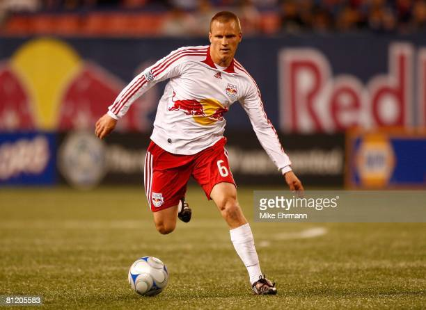 Seth Stammler of the New York Red Bulls plays the ball forward against the New England Revolution at Giants Stadium in the Meadowlands on April 19,...
