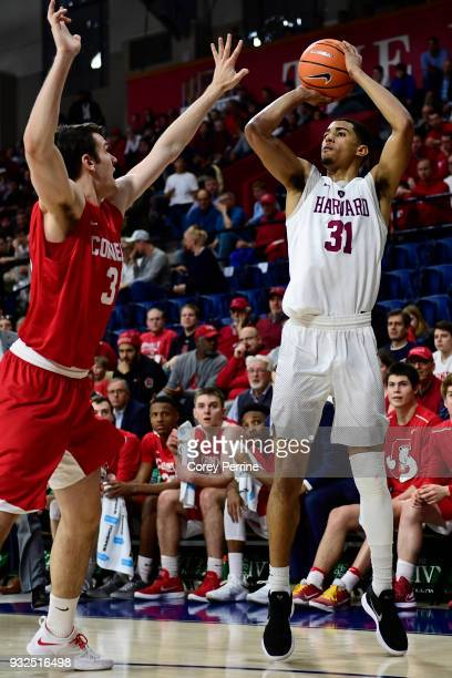 Seth Towns of the Harvard Crimson shoots the ball against Jimmy Boeheim of the Cornell Big Red during the first half of a semifinal round matchup in...