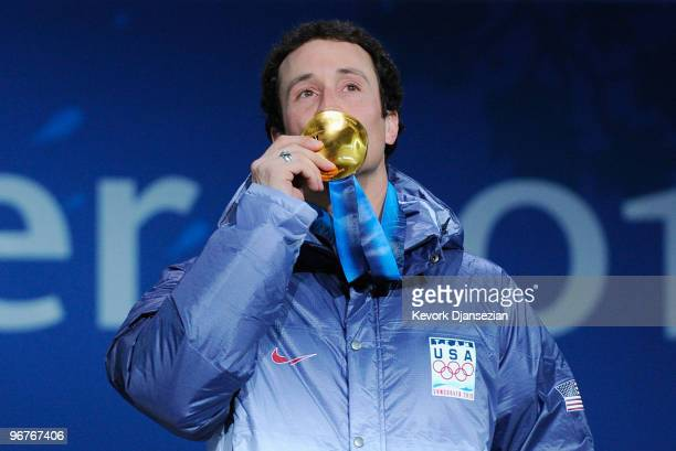 Seth Wescott of the United States kisses celebrates winning the gold medal during the medal ceremony the Men's Snowboard Cross on day 5 of the...