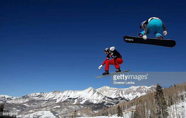 Seth Wescott of the USA and Lindsey Jacobellis of the USA take a practice run together before the finals of the FIS Snowboardcross World Cup 2010 on...