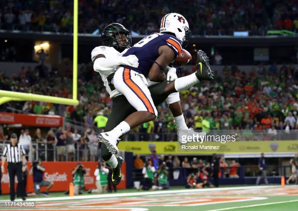 Seth Williams of the Auburn Tigers makes the game winning touchdown pass against Verone McKinley III of the Oregon Ducks in the fourth quarter during...