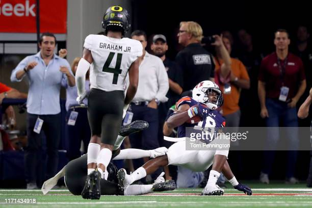 Seth Williams of the Auburn Tigers scores the game winning touchdown against Verone McKinley III of the Oregon Ducks and Thomas Graham Jr #4 of the...