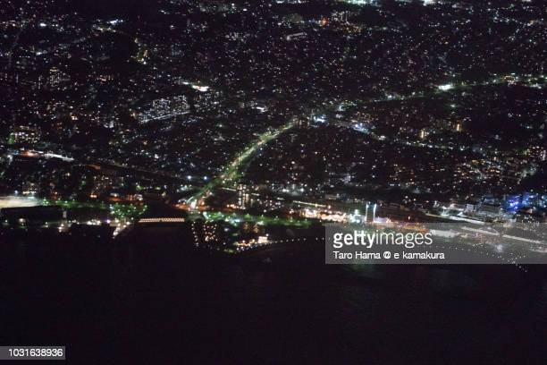 Seto Inland Sea and Akashi city in Hyogo prefecture in Japan night time aerial view from airplane