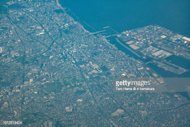 Seto Inland Sea and Akashi city in Hyogo prefecture in Japan sunset time aerial view from airplane
