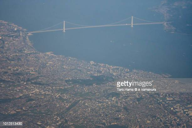 Seto Inland Sea and Akashi Strait Bridge in Kobe city in Hyogo prefecture in Japan sunset time aerial view from airplane