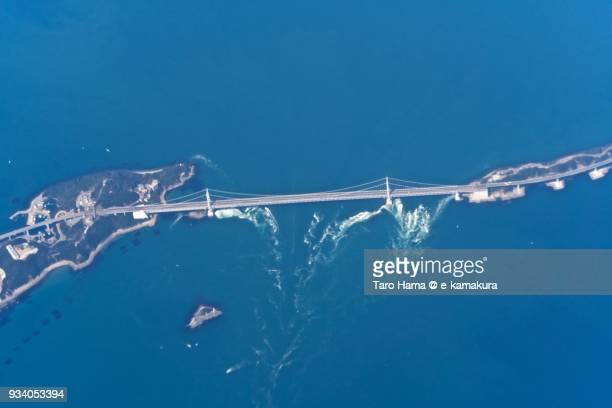 Seto Inland Sea, and eddying current in Naruto strait and Onaruto Bridge (Great Naruto Bridge) in daytime aerial view from airplane