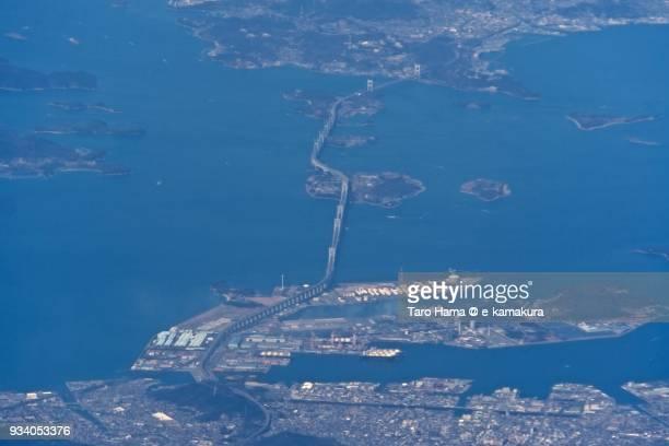 Seto Inland Sea and Great Seto Bridge (Seto Ohashi Bridge) in Marugame and Sakaide cities in Kagawa prefecture in Japan daytime aerial view from airplane