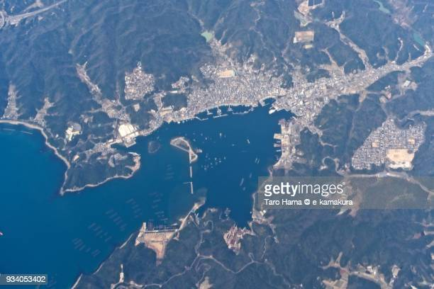 Seto Inland Sea and harbor in Minamiawaji city in Awaji Island in Hyogo prefecture in Japan daytime aerial view from airplane