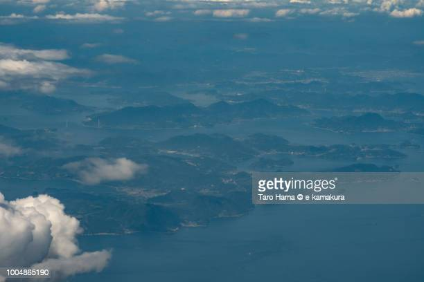 Seto Inland Sea and islands in Imabari city in Ehime prefecture in Japan daytime aerial view from airplane