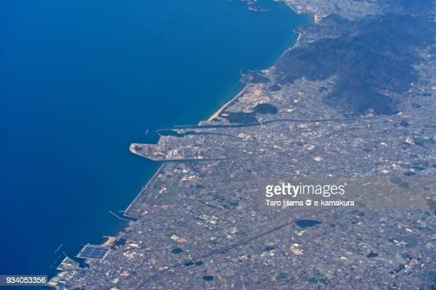 Seto Inland Sea and Kanonji city in Kagawa prefecture in Japan daytime aerial view from airplane