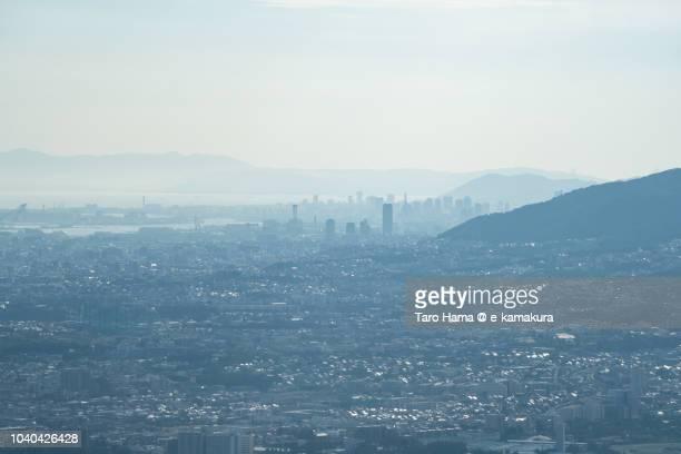 Seto Inland Sea, and Kobe, Ashiya and Nishinomiya cities in Hyogo prefecture in Japan daytime aerial view from airplane