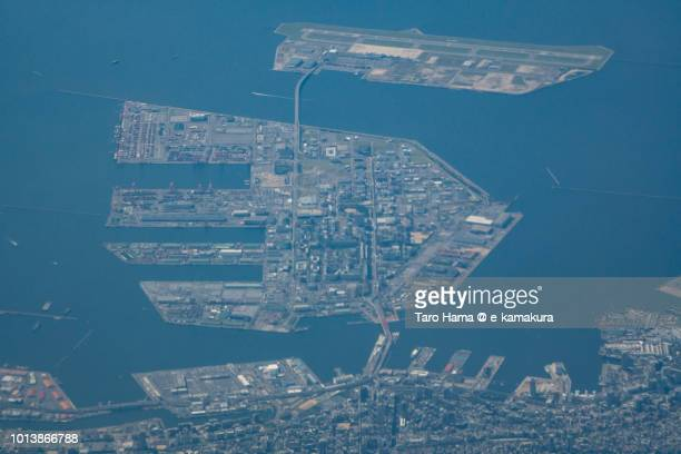 Seto Inland Sea and Kobe Port Island and Sannomiya in Kobe city in Japan daytime aerial view from airplane