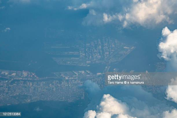 Seto Inland Sea and Kobe Port Island in Hyogo prefecture in Japan sunset time aerial view from airplane