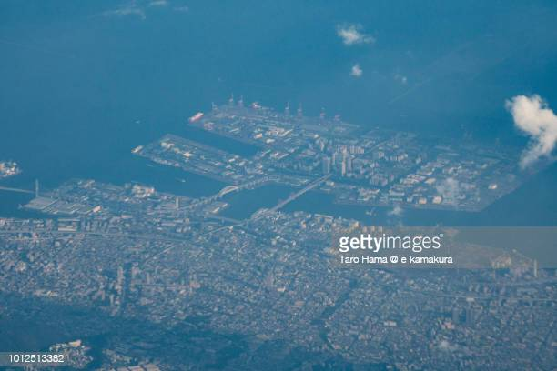 Seto Inland Sea and Kobe Rokko Island in Hyogo prefecture in Japan sunset time aerial view from airplane