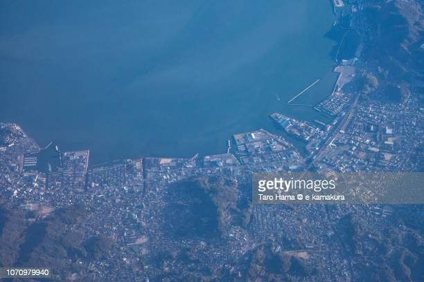 Seto Inland Sea and Kurashiki city in Okayama prefecture in Japan sunset time aerial view from airplane