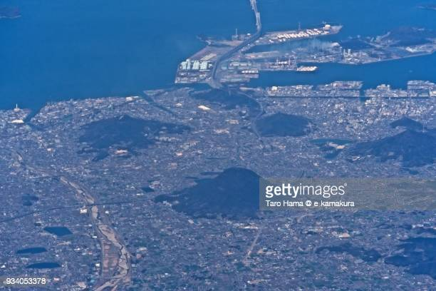 Seto Inland Sea and Marugame and Sakaide cities in Kagawa prefecture in Japan daytime aerial view from airplane