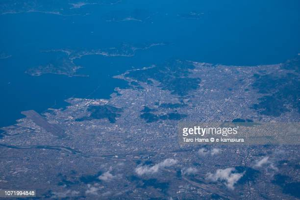 Seto Inland Sea and Matsuyama city in Ehime prefecture in Japan daytime aerial view from airplane