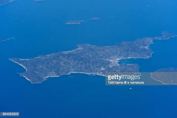 Seto Inland Sea and Nakajima island in Matsuyama city in Ehime prefecture in Japan daytime aerial view from airplane