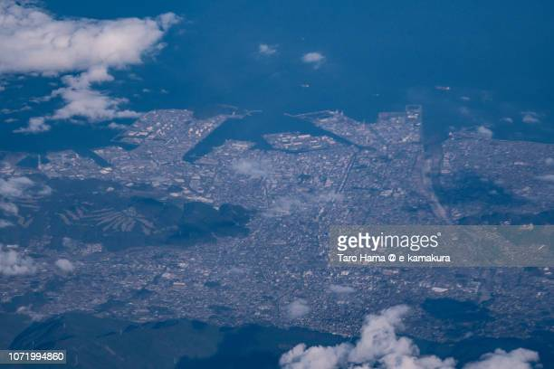 Seto Inland Sea and Niihama city in Ehime prefecture in Japan daytime aerial view from airplane