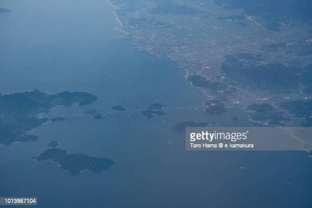Seto Inland Sea and Nishiseto Expressway (Shimanami Kaido) in Japan daytime aerial view from airplane