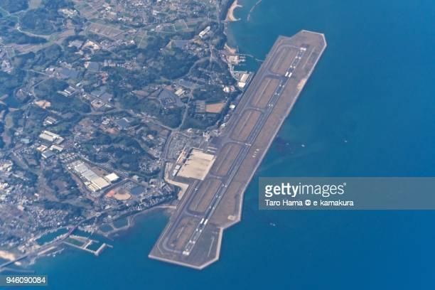 seto inland sea and oita airport in kunisaki city in oita prefecture in japan daytime aerial view from airplane - 大分県 ストックフォトと画像