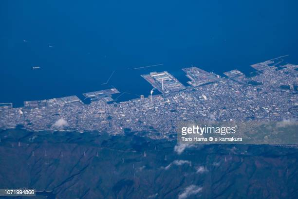 Seto Inland Sea and Shikokuchuo city in Ehime prefecture in Japan daytime aerial view from airplane