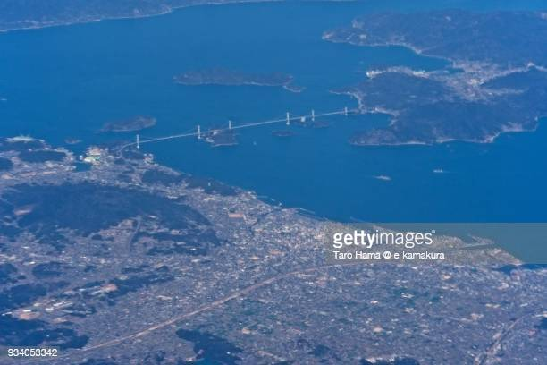 Seto Inland Sea and Shimanami Expressway (Nishiseto Expressway) in Imabari city in Ehime prefecture in Japan daytime aerial view from airplane