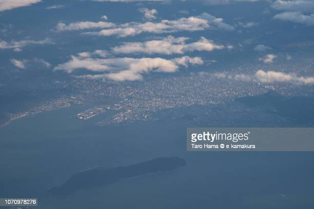 Seto Inland Sea and Takamatsu city in Kagawa prefecture in Japan sunset time aerial view from airplane