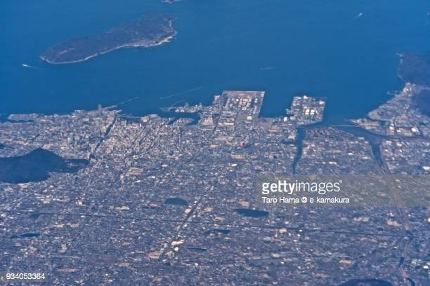 Seto Inland Sea and Takamatsu city in Kagawa prefecture in Japan daytime aerial view from airplane