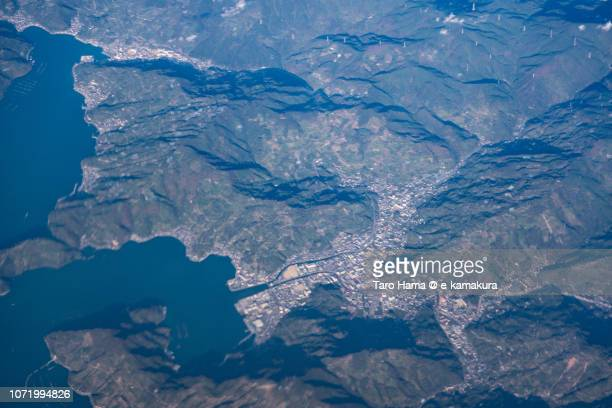Seto Inland Sea and Yawatahama city in Ehime prefecture in Japan daytime aerial view from airplane