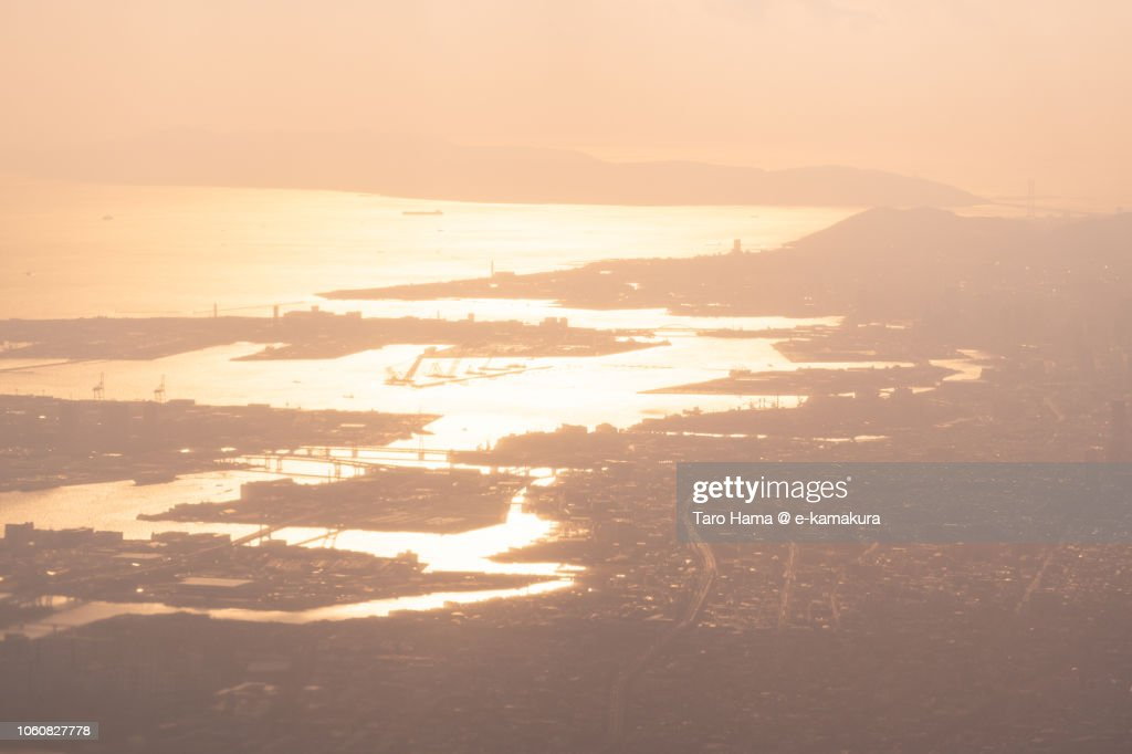 Seto Inland Sea, Awaji Island and Kobe city in Japan sunset time aerial view from airplane : ストックフォト
