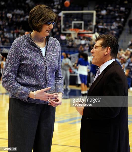 Seton Hall head coach Anne Donovan left and Connecticut head coach Geno Auriemma talk before their teams square off at the XL Center in Hartford...