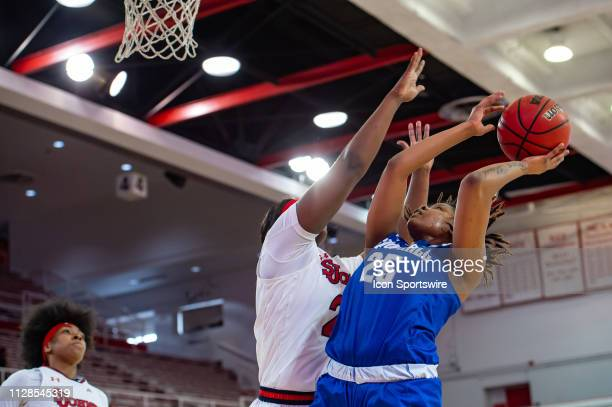 Seton Hall Pirates guard Desiree Elmore scores a basket during the first half of the women's college basketball game between the Seton Hall Pirates...