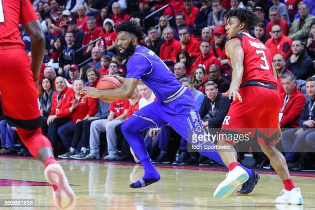 Seton Hall Pirates guard Eron Gordon dribbles without a shoe during the first half of the College Basketball game between the Seton Hall Pirates and...
