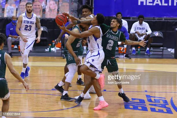 Seton Hall Pirates guard Jared Rhoden drives to the basket and is fouled by Wagner Seahawks guard Alex Morales during the second half of the college...