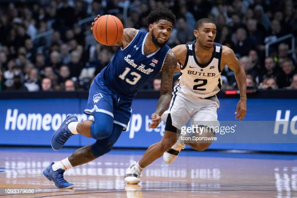 Seton Hall Pirates guard Myles Powell drives past Butler Bulldogs guard AaronThompson during the men's college basketball game between the Butler...