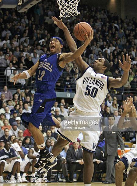Seton Hall Pirates guard Paul Gause goes up for a shot against Villanova Wildcats forward Will Sheridan Tuesday January 17 2006 at The Pavilion in...