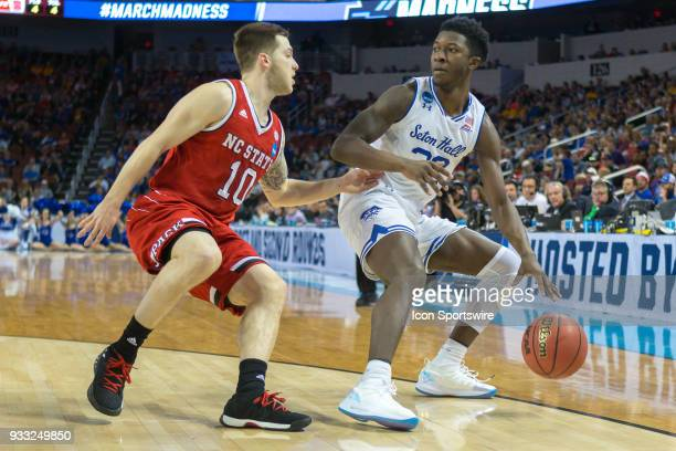 Seton Hall Pirates guard Quincy McKnight looks to get around North Carolina State Wolfpack guard Braxton Beverly during the NCAA Tournament first...