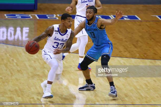 Seton Hall Pirates guard Shavar Reynolds brings the ball upcourt against Georgetown Hoyas guard Donald Carey during the college basketball game...