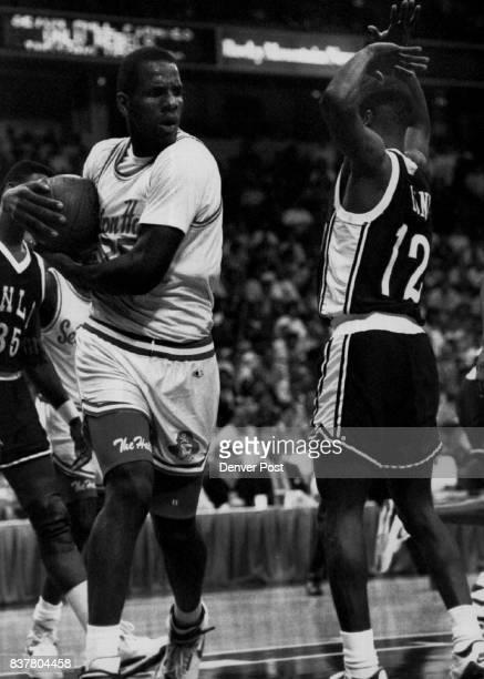 Seton Hall Ramon Ramos w/ball #12 UNLV Anderson Hunt defending Basketball Collegiate Credit The Denver Post