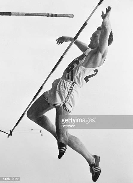 Sets New Olympic Pole Vault Record. Melbourne, Australia: Rev. Bob Richards, of Laverne, California, is shown vaulting over the bar at 14 feet, 11...