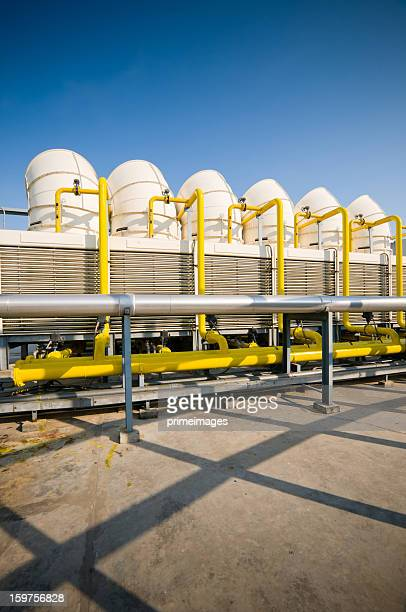 sets of cooling towers in conditioning systems - cooling rack stock photos and pictures