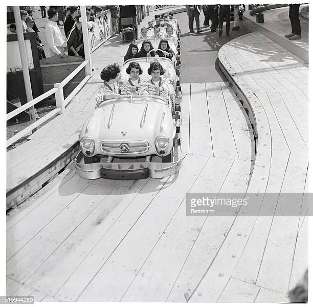 Sets of triplets drive together in the automobile amusement ride at Palisades Park of New Jersey Triplets from New Jersey New York and Connecticut...