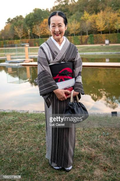 Setsuko Klossowska attends Hiroshi Sugimoto's Exhibition at Chateau de Versailles on October 14 2018 in Versailles France