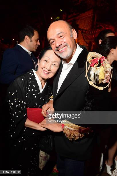 Setsuko Klossowska de Rola and Christian Louboutin attend the Loubicircus Party by Christian Louboutin at Musee des Arts Forains as part of Paris...