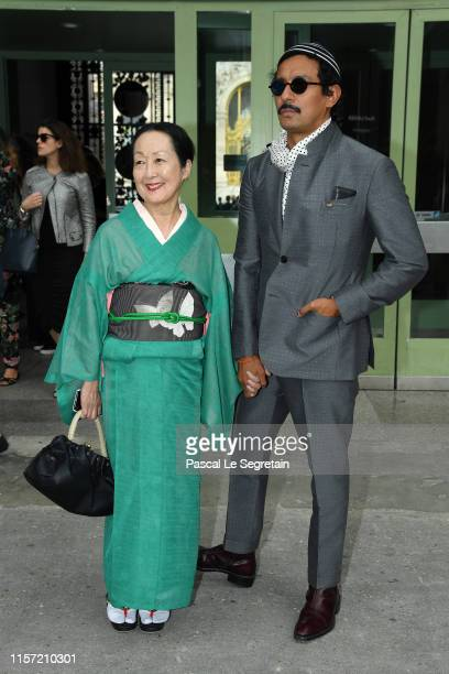 Setsuko Klossowska de Rola and Haider Ackermann pose prior the Karl Lagerfeld Homage at Grand Palais on June 20, 2019 in Paris, France.