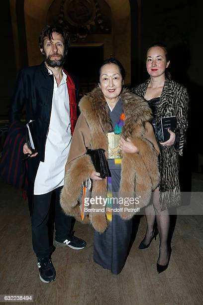 Setsuko Klossowska De Rola standing between her daughter Harumi Klossowska De Rola and Harumi's husband Benoit Peverelli attend the Berluti Menswear...